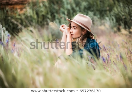 woman lying in long grass stock photo © is2