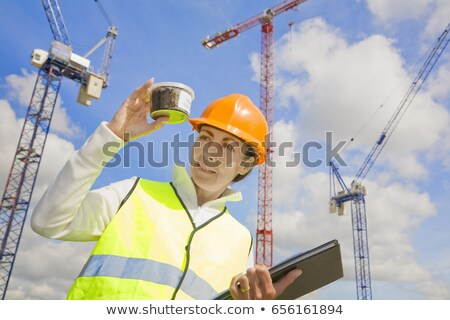 Woman viewing sample at building site Stock photo © IS2