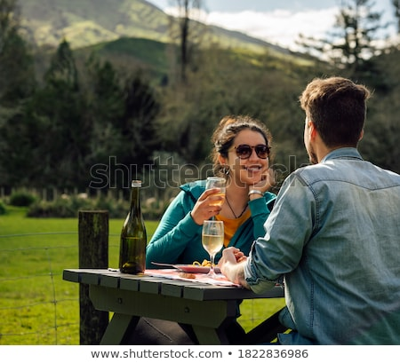 woman drinking and camping in inspiring mountain landscape stock photo © blasbike