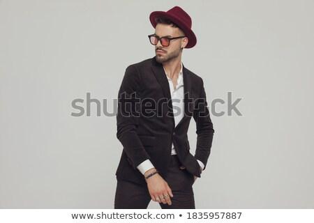 любопытный бизнесмен черный костюм стороны кармана белый Сток-фото © feedough