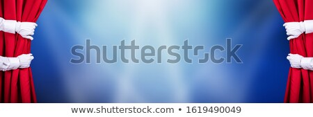 Stock photo: Two People Opening Red Stage Curtain