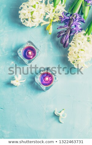Greeting card with blue candles and hyacinths Stock photo © artsvitlyna