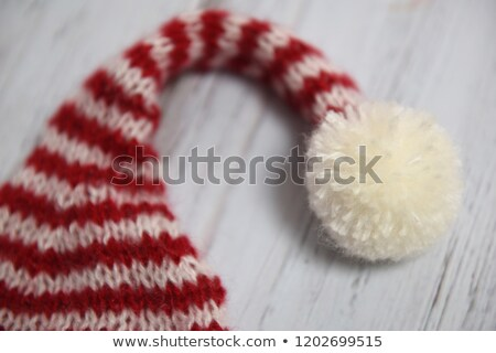 Winter Holidays knitted red hat with white pom-pom Stock photo © robuart