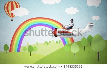 cartoon · vliegtuig · regenboog · hemel · wolken · vleugels - stockfoto © colematt