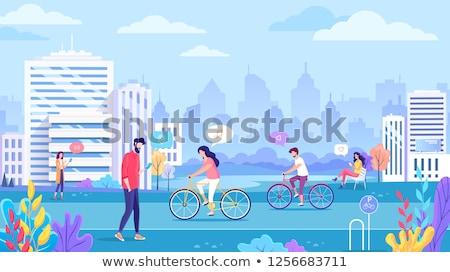 woman outdoors with bicycle on the street chatting by mobile phone drinking coffee stock photo © deandrobot