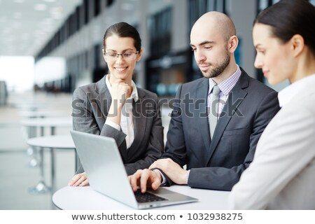 confident businessman in formalwear consulting colleagues stock photo © pressmaster