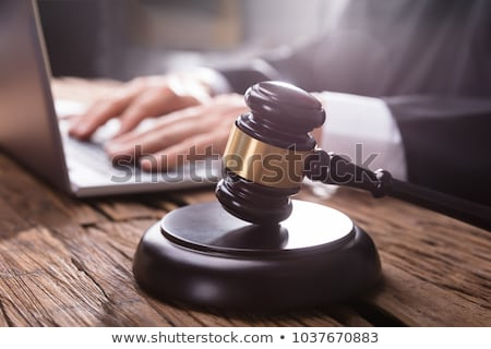 Stock photo: Male Judge In A Courtroom Typing On Laptop