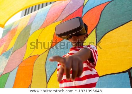 Alulról fotózva kilátás aranyos játékos afroamerikai iskolás fiú Stock fotó © wavebreak_media