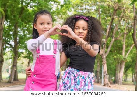 Weinig asian meisje vriend afrikaanse etniciteit Stockfoto © pressmaster