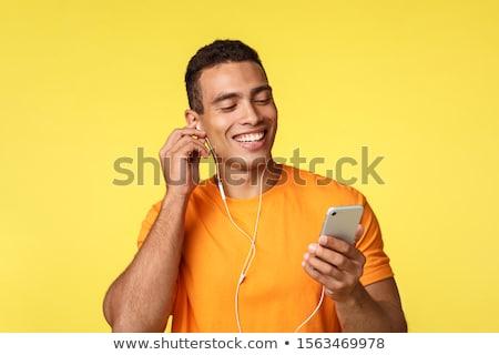 Sorridere maschile giovane arancione tshirt Foto d'archivio © benzoix