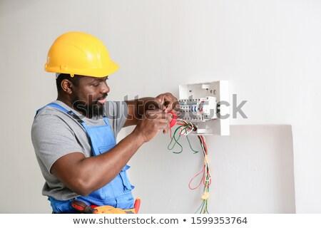 Africano americano manutenção eletricista engenheiro sorridente trabalhar Foto stock © AndreyPopov