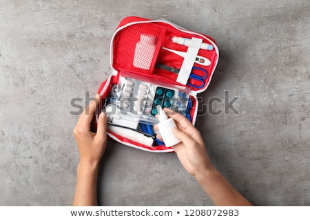 Red first aid kit and stethoscope equipment Stock photo © jossdiim