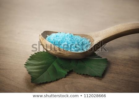 blue bath salt with wooden spoon stock photo © tetkoren