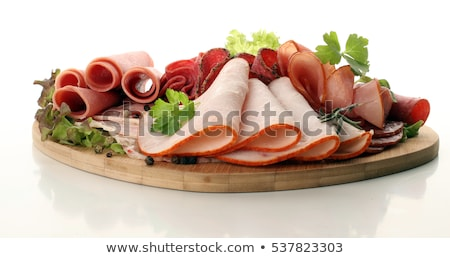 Cutting sausage and cured meat with a parsley Stock photo © kayros