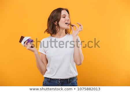 Belo moda mulher alimentação chocolate dourado Foto stock © lunamarina