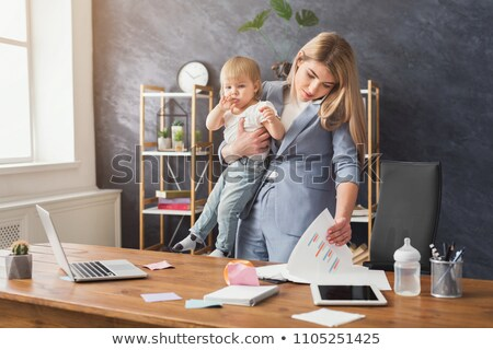 multitasking woman looking at the time stock photo © photography33