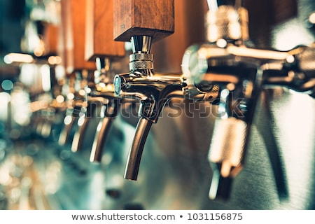 chrome beer taps at the bar in the pub Stock photo © tarczas