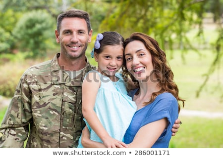 soldier and two women stock photo © acidgrey