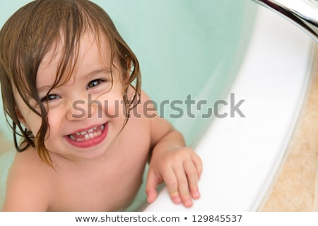 Cute Toddler Giving Toothy Smile from the Bath Tub Stock photo © ozgur