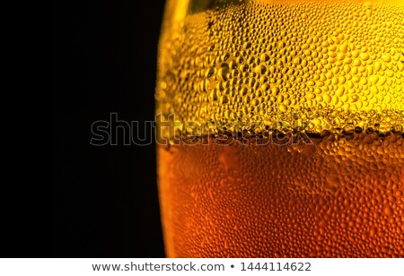 Glass full of foam and beer against a black background Stock photo © wavebreak_media