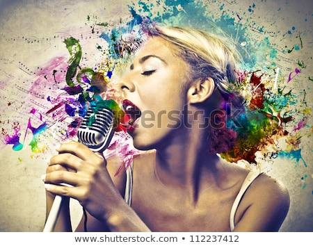 blond singing with vintage microphone stock photo © sumners