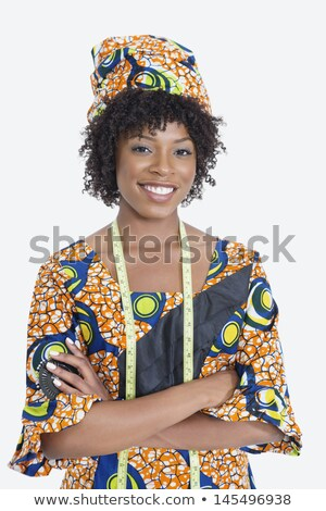Smiling female tailor with hands crossed stock photo © deandrobot