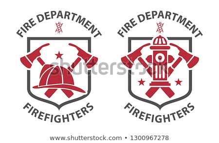Stock photo: extinguisher with firefighter hat