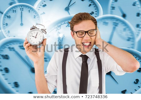 Geeky businessman holding alarm clock Stock photo © wavebreak_media