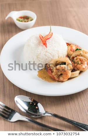 Rice topped with stir-fried squid basil (Thai food) Stock photo © nalinratphi