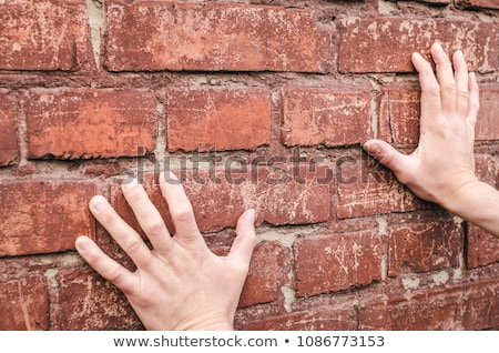 businessman rests hands against wall Stock photo © Paha_L