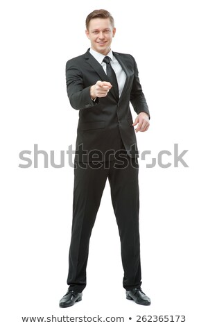 happy smiling businessman in suit pointing at you stock photo © dolgachov