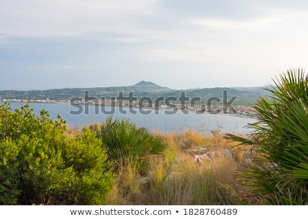 Postcard of panorama of white beach and city Alicante, Spain stock photo © sebikus