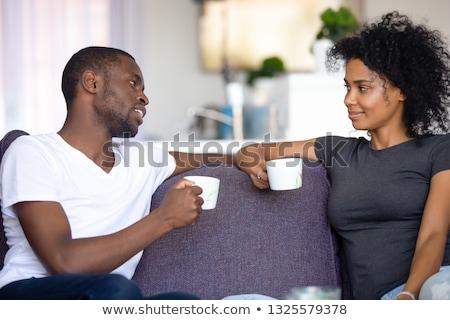 Férj feleség osztás megnyugtató reggeli ágy Stock fotó © Kzenon