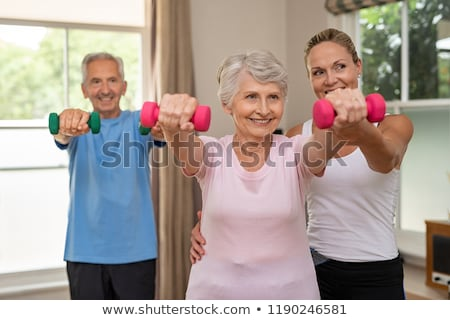 Physiotherapist assisting senior woman in exercise Stock photo © wavebreak_media
