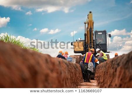 Hidrolik ekskavatör çalışmak toprak geri kamyon Stok fotoğraf © brianguest