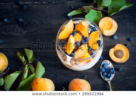 Grieks yoghurt abrikoos glas gedroogd Stockfoto © IngridsI