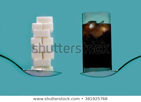 cola drink and pile of sugar cubes stock photo © nito