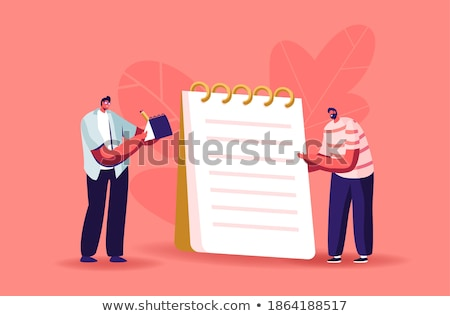 Person Writing On Chequered Spiral Notepad Stock photo © AndreyPopov