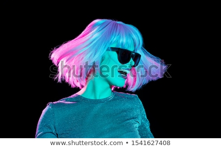 woman in sunglasses over ultra violet background stock photo © dolgachov