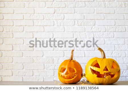 jack o lantern and halloween decorations at home stock photo © dolgachov