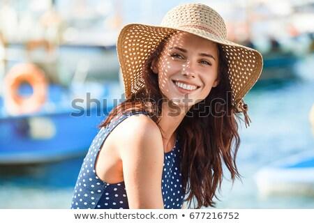 Vrouw zomer hoed witte geïsoleerd strand Stockfoto © OleksandrO