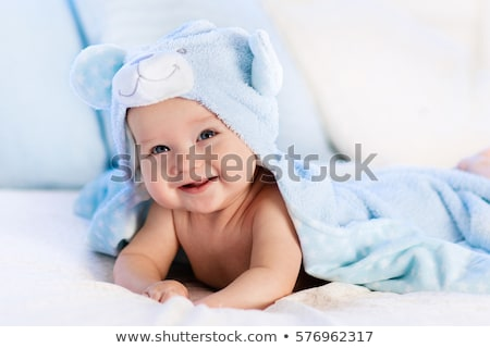 smiling baby covered with blanket stock photo © lichtmeister