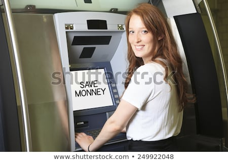 A student using a ATM machine at school Stock photo © Lopolo