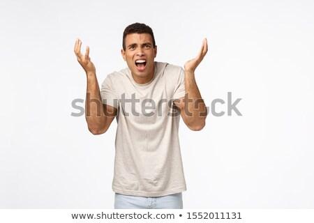 Csalódott jóképű férfi póló kezek magasban csalódott elégedetlen Stock fotó © benzoix