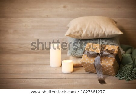 Comfortable cushions and white burning candles in cozy living ro Stock photo © dashapetrenko