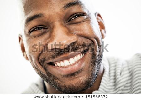 クローズアップ 若い男 笑みを浮かべて 男性 肖像 思考 ストックフォト © Jasminko