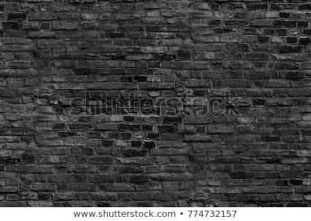 Gray bricks in worn out brick wall seamless pattern Stock photo © evgeny89