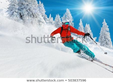Adam kayakçılık turuncu ceket dağ gökyüzü Stok fotoğraf © RuslanOmega