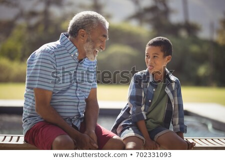 Elderly man relaxing poolside Stock photo © photography33