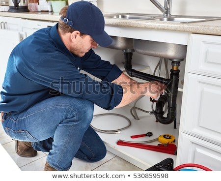 Attractive Plumber With A Wrench Сток-фото © kurhan
